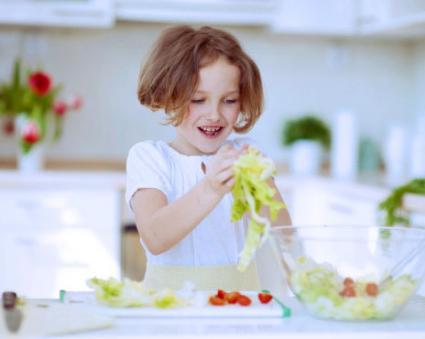 Little girl making meal