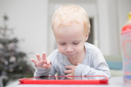 toddler with tablet