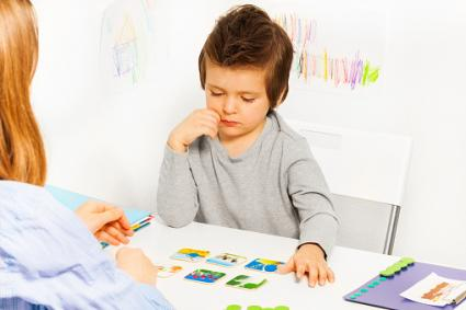 Boy playing developing game
