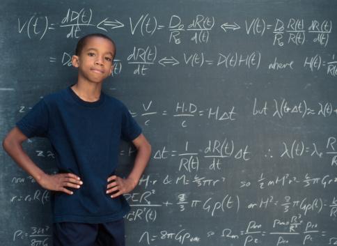 Boy standing in front of chalkboard