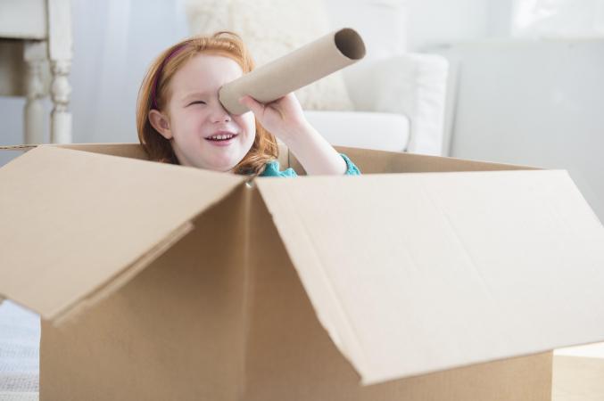 girl in cardboard box