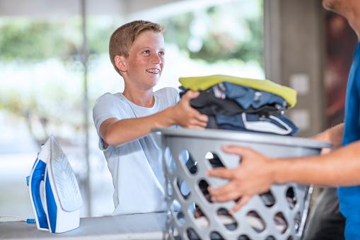 Boy helping with laundry