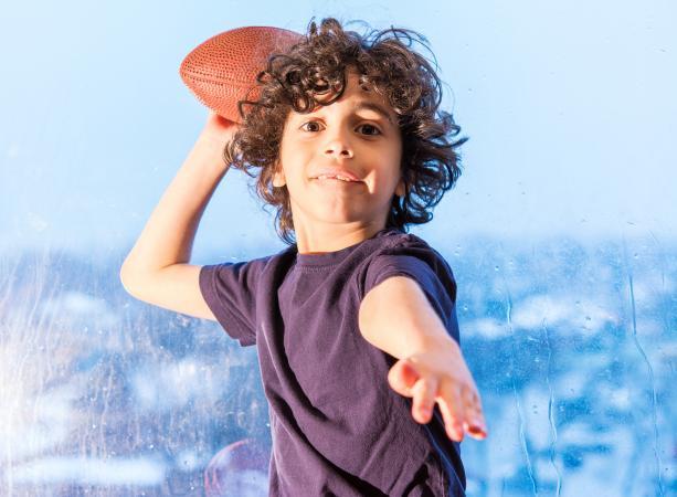 playing football inside