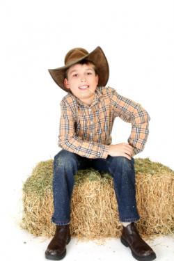 kid playing cowboy