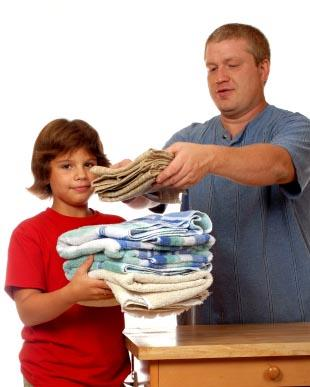 Father and son work on chores