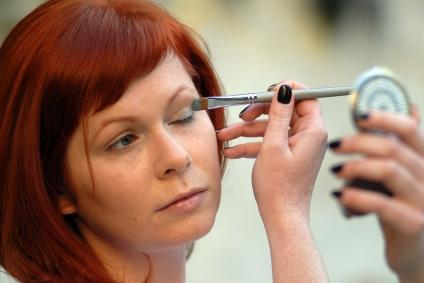 woman applying green eyeshadow