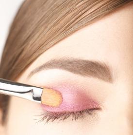 applying eye shadow with a brush
