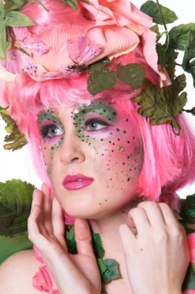 Woman dressed as a fairy, complete with face paint