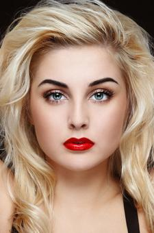 Peach/fair-skinned woman wearing red lipstick