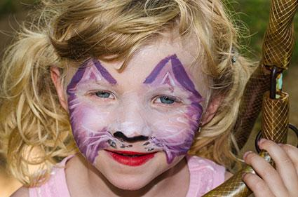 Girl with purple painted cat face