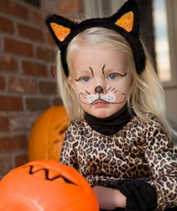 Girl in leopard costume with painted cat face