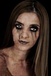 Applying  Makeup on Three Ways To Do Zombie Makeup