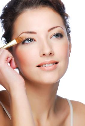 Brunette model applying makeup