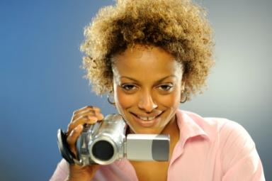 Woman with video camera