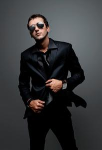 man in all black and sunglasses