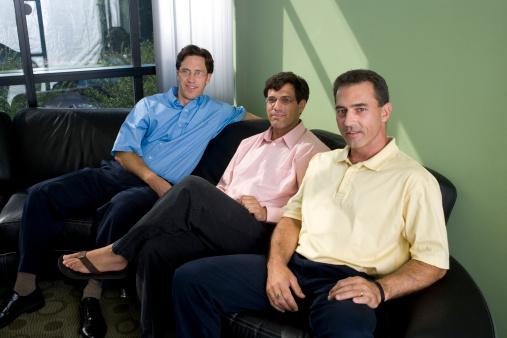 businessmen sitting in an office