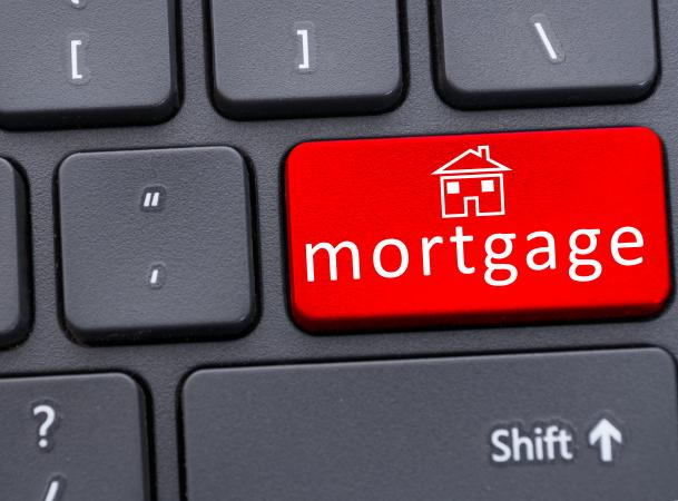 Mortgage text on red keyboard