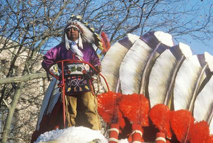 Native American on a float in Macy's 50th annual Thanksgiving Parade in New York City.