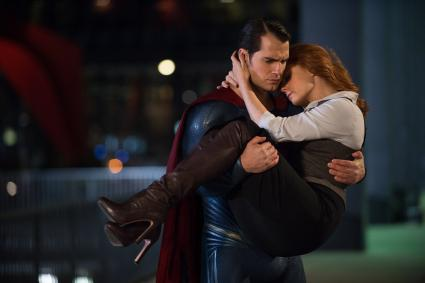 Superman carrying Lois