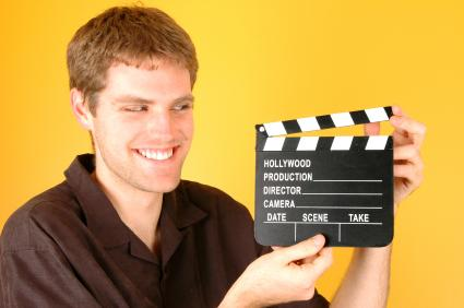 Film maker with clapboard.
