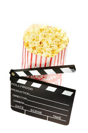 A clapboard and popcorn.