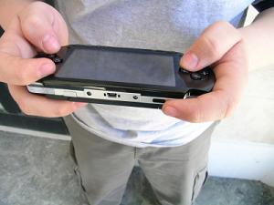 Kid playing PSP