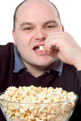 man eats popcorn