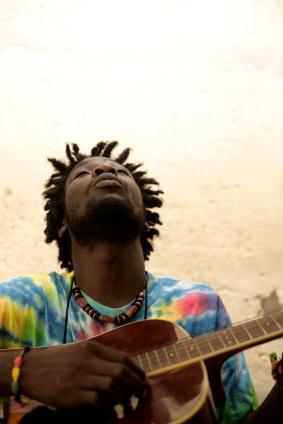 African man playing guitar