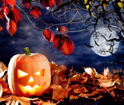 Spooky jack-o-lantern and full moon