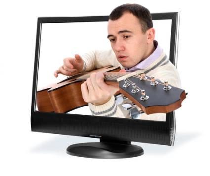 Man playing guitar in TV