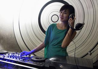 Woman DJ with equipment