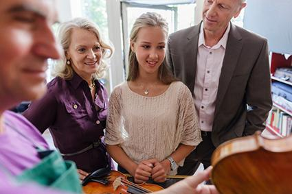 Grandparents buying a violin for granddaughter