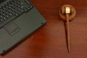 Auction gavel with laptop