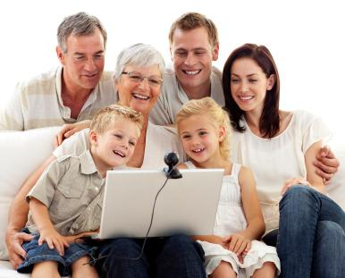 Family gathered around a computer
