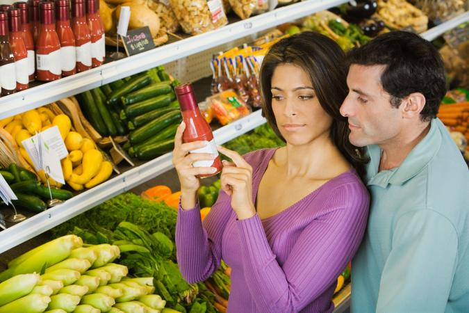 Couple reading food label