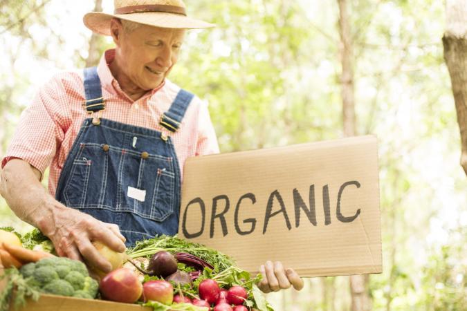 organic farmer with produce