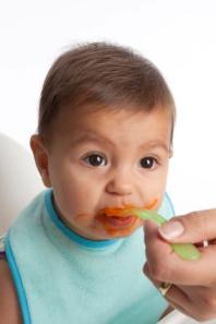 baby eating carrots