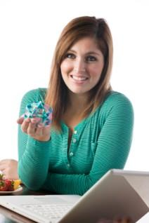 Woman with geometric origami figure.