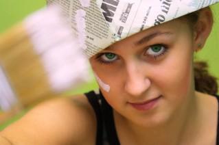 woman wearing a paper hat