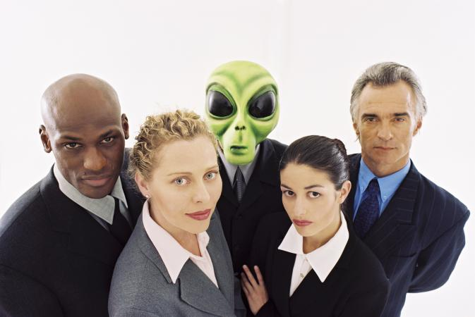 Businesspeople with an extraterrestrial