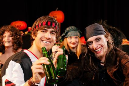 adults in Halloween costumes. Grown-up games are perfect for group parties!