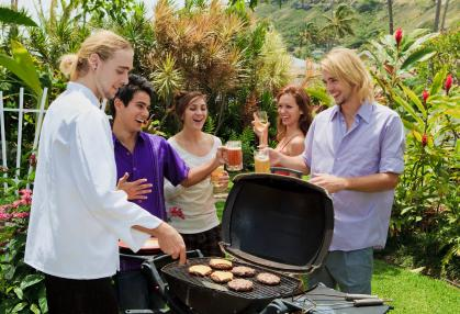 Fellow graduates at an open house barbecue