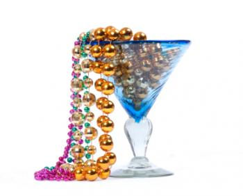 Mardi Gras beads in glass centerpiece