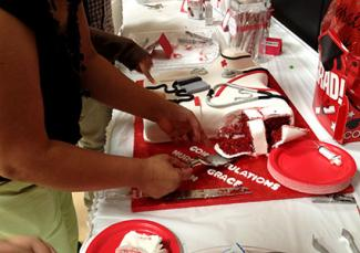 Cutting cake at nursing school graduation party