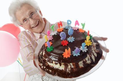 senior with 90th birthday cake