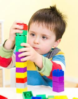 Boy playing with construction blocks