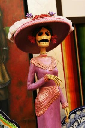 Calacas are whimsical figures prominently featured in Day of the Dead celebrations.