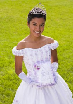 Teenage girl with bible at quinceanera