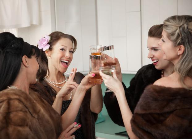 Retro women with cocktails at party