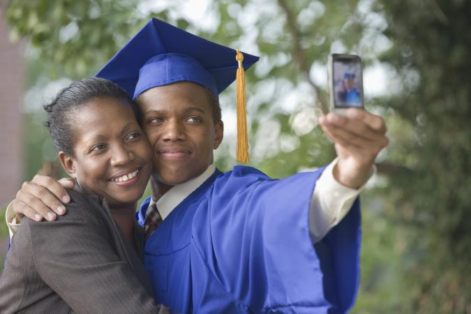 Graduating teenager with mother